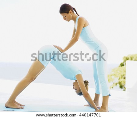 Women practicing yoga - stock photo
