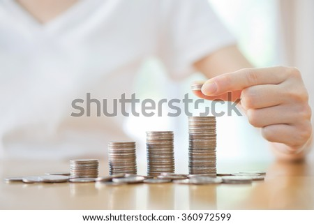 women put coin stack money for money growth concept - stock photo