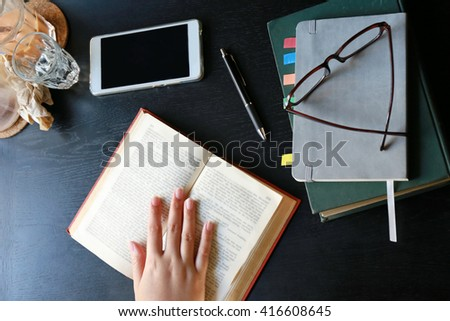 women read book on wooden table - stock photo