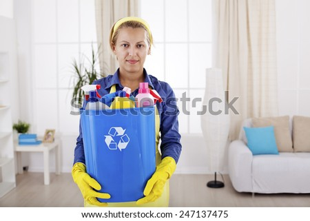 Women recycling empty plastic bottles after cleaning