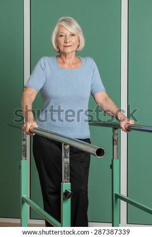 Women rehabilitating her legs - stock photo