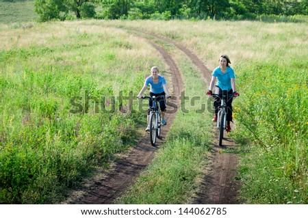 women relax biking outdoors - stock photo