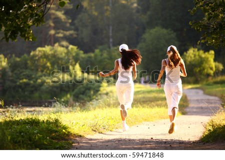 women run - stock photo
