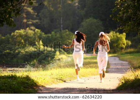 women run - stock photo