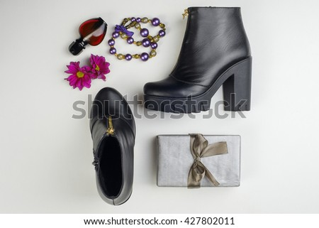 Women's accessories and cosmetics. Top view photo of colorful and glamour objects. There are shoes and gift - stock photo