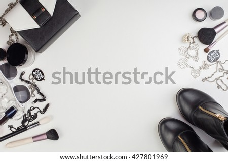 Women's accessories and cosmetics. Top view photo of colorful and glamour objects with free space for logo. There are shoes and perse - stock photo