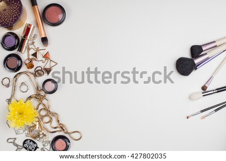 Women's accessories and cosmetics. Top view photo of colorful and glamour objects with free space for logo. There are makeup brushes - stock photo