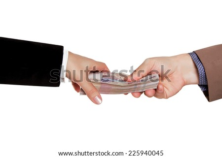 Women's and men's hand with a wad of money - stock photo