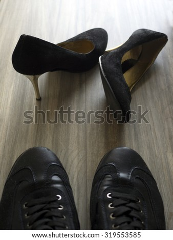 women's and men's shoes lie on the floor - stock photo