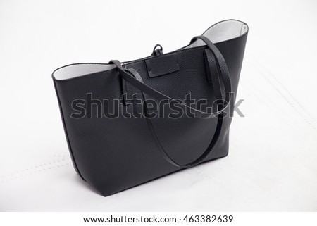 Women's bag in black on a white background