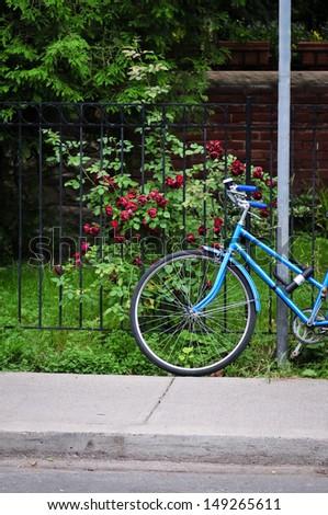Women's bicycle parked near steel fence on the street in Toronto - stock photo