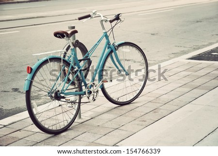 Women's bicycle parked on the street in Toronto