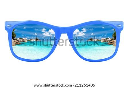 Women's blue sunglasses and ocean - stock photo