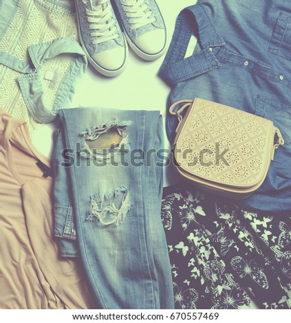 Women's clothes. Jeans, shirt, bag, jacket, sneakers. Sale, second hand. Autumn collection. Top view,