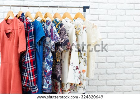 Women's clothes on hanger - stock photo