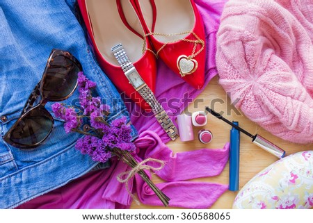 Women's clothing and accessories on wooden table background