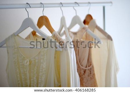 Women's clothing is hanging on hangers