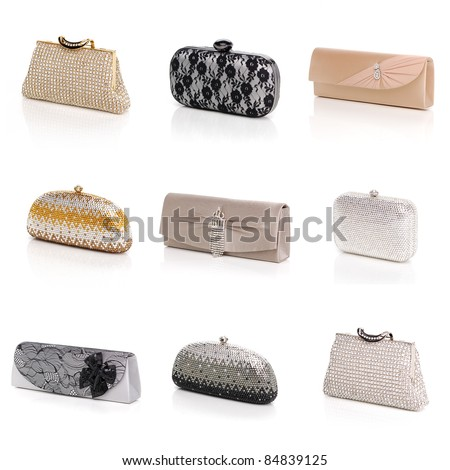 Women's elegant evening handbags on white background - stock photo