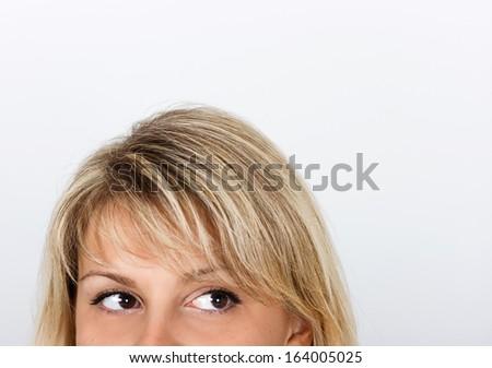 women's eyes peek out from behind framework - stock photo