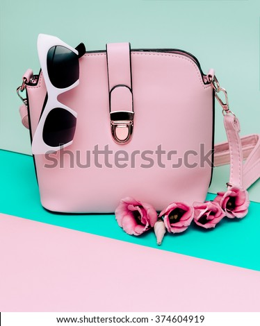 Women's Fashion Accessories. Bag and Sunglasses. Pastel Colors trend Summer - stock photo