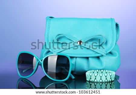 Women's fashion accessories on bright colorful background - stock photo