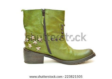Women's fashion boots green in cowboy style isolated on white background. Photo shoe in profile close-up. Boots with zipper and decorative stars and studs. Autumn - spring leather shoes  - stock photo