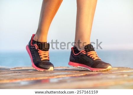 women's feet at the start of the race. concept, sunset - stock photo