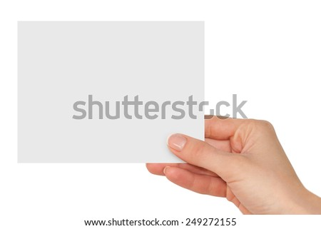 Women's fingers holding a blank white card
