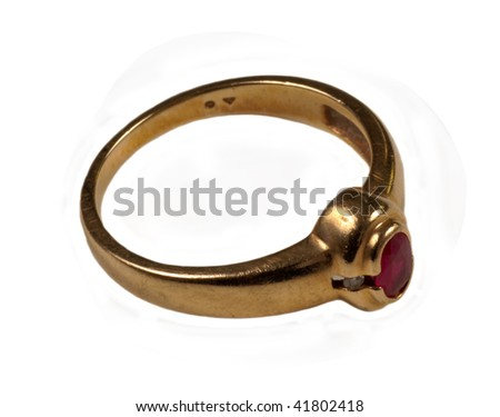 Women's gold ruby ring isolated - stock photo