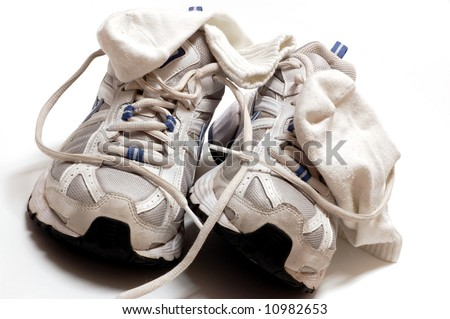Women's gym shoes and socks on a white background - stock photo