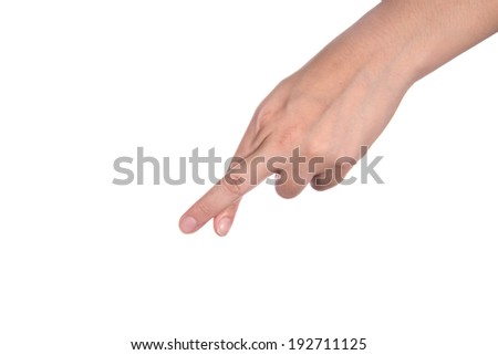 women's hand crossing fingers on a white isolated background