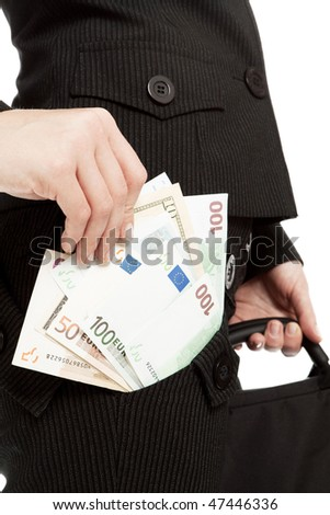 Women's hand to get the money from his pocket a business suit. In the background the other hand with a working bag