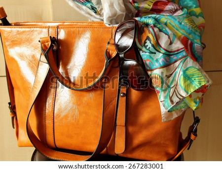 Women's handbags, sunglasses and scarf  - stock photo
