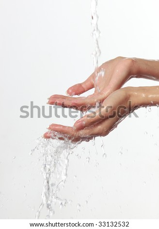 Women's hands and stream of water On white background. - stock photo