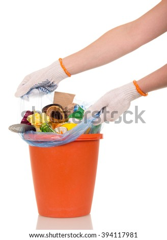 Women's hands are removed from the bucket bag with household waste isolated on white background. - stock photo