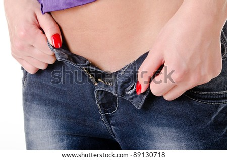 women's hands removed from the female hip jeans