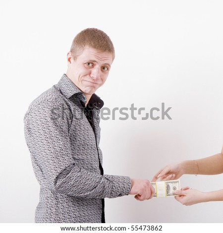 women's hands taken away money from the hurt man - stock photo