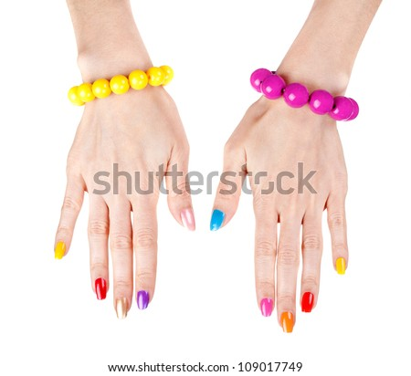 Women's hands with a fashionable multi-colored nail polish with the bracelets. Studio, isolate on white. - stock photo