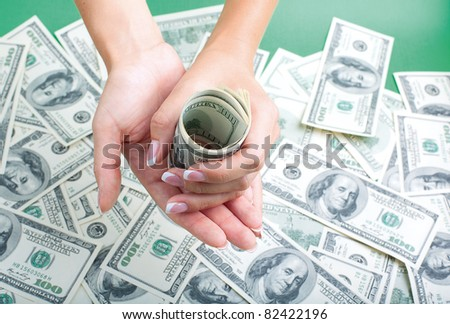women's hands with a money - stock photo