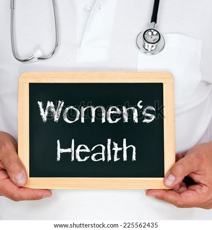 Women's Health - Physician with chalkboard - stock photo
