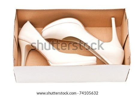 Women's high heels shoes in box isolated on white background - stock photo
