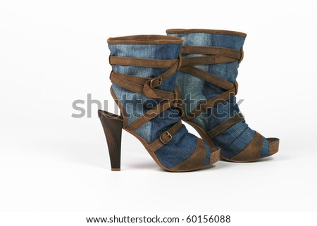 women's jeans high-heeled shoes and brown leather straps - stock photo