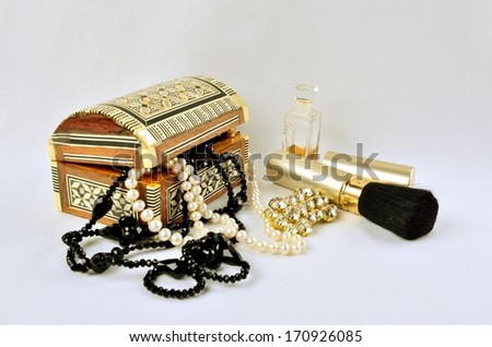 Women's jewelry, perfumes and cosmetics in still life
