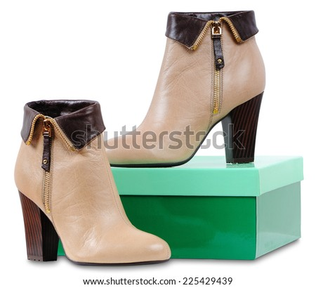 Women's leather boots with high heels and shoe box - stock photo