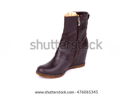 Women's leather shoes isolated on white background. Women's leather boots.