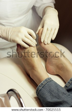 Women's legs in Spa salon