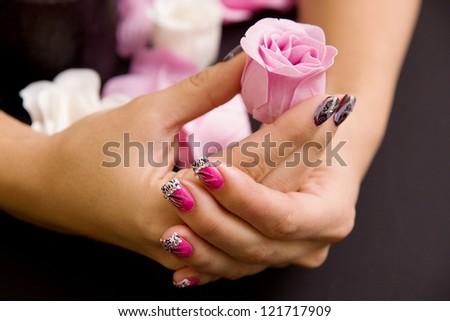 Women's manicure arranged - stock photo