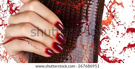 Women's manicure with maroon-red gradient polish on the nails. - stock photo