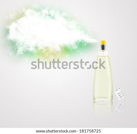 women's perfume in beautiful bottle spraying colorful cloud, copyspace in cloud - stock photo