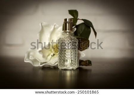 Women's perfume in beautiful bottle with roses - stock photo
